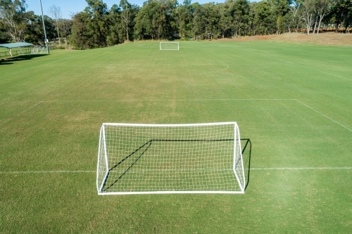 Aerial oblique view of soccer field and goals.