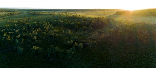 Aerial panorama of a farm paddock at dusk.
