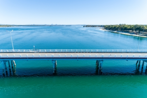 Aerial view of a bridge over water with no traffic.