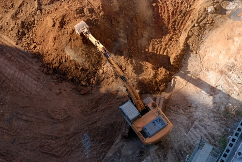 Aerial view of an earth mover in operation on a building site