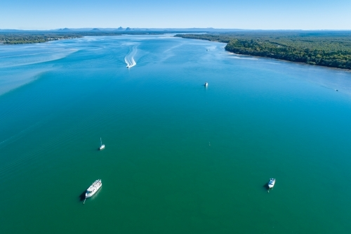 Aerial view of boats on Pumicestone Passage, Bribie Island.