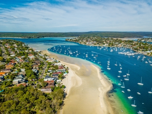 Aerial views of Gunnamatta beach and water views with the many luxury yachts and boats moored