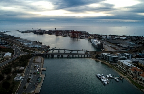 An aerial view of a water inlet and the surrounding port