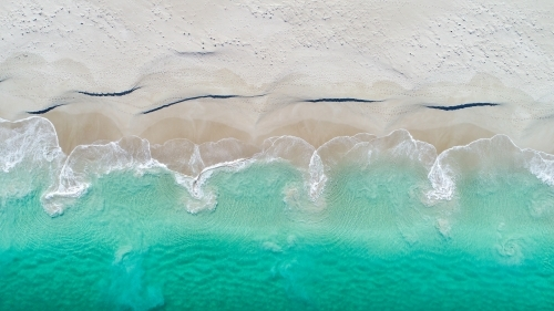 An aerial view of water receeding into the ocean