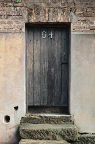 An old door on a sandstone house.