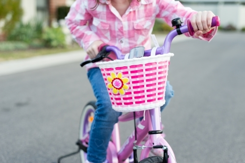 Anonymous girl riding her bike