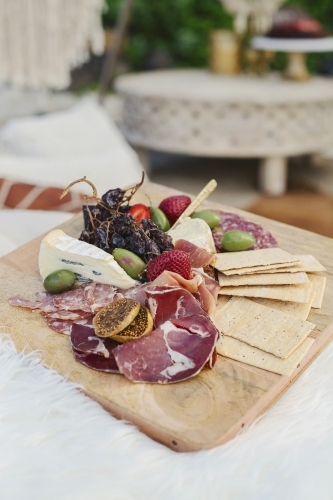 Antipasto platter with boho details in the background