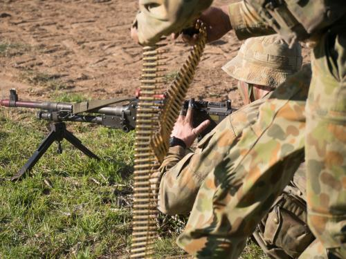 Australian Army Reserve Exercise - Soldier Lying with Gun and Bullets