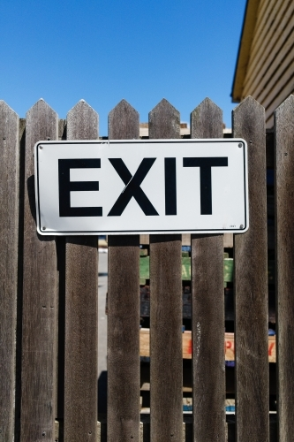 Exit sign on timber gate