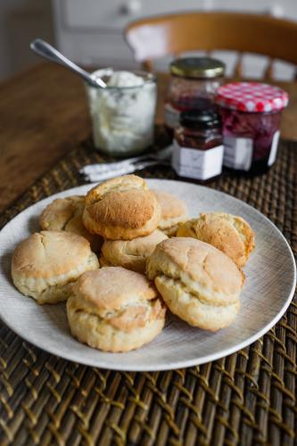 Plate of scones with cream and jam