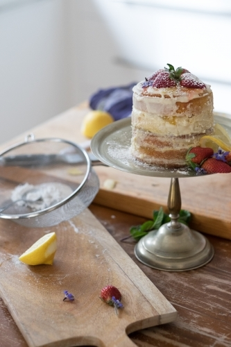 Home baked lemon layer cake in kitchen