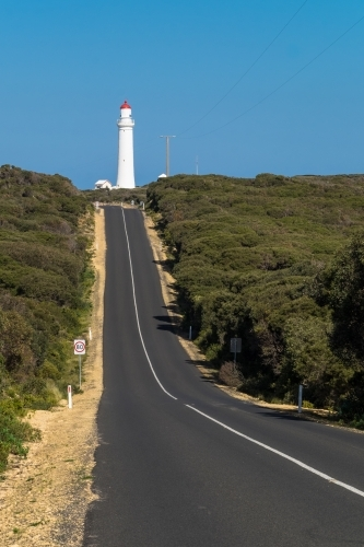 Long straight road leading to heritage Lighthouse