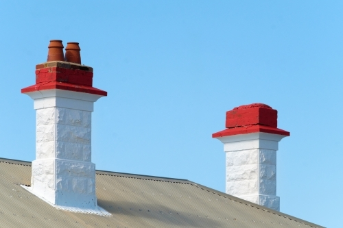 White chimneys with painted red tops
