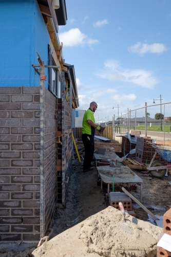 Bricklayer working on new house wall