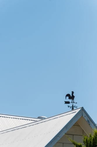 Weather vane on country house