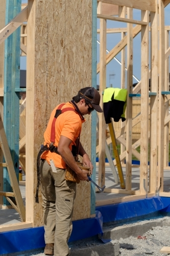 Tradie working on house building site