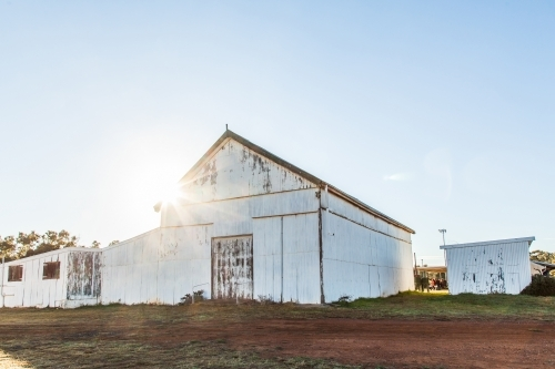 Sun flare over showground pavilion shed in rural country town