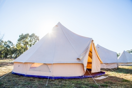 Tent with open flaps in the morning sunlight