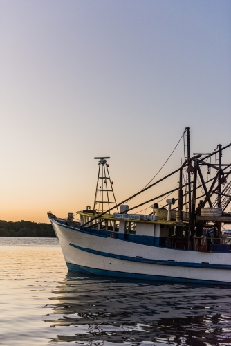 Fishing Trawler on a river at dusk