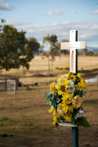 Memorial cross for road traffic victim on country road