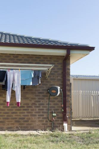 Backyard Washing Line Filled with Clothes