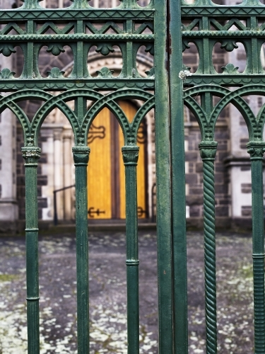 Wrought iron gates with church door in background