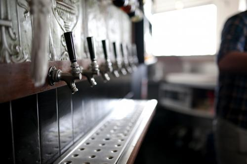 Bar taps behind bar at a local craft beer pub