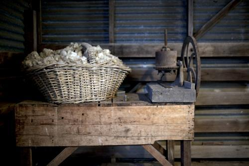 Basket of wool on old wooden table in farm shed