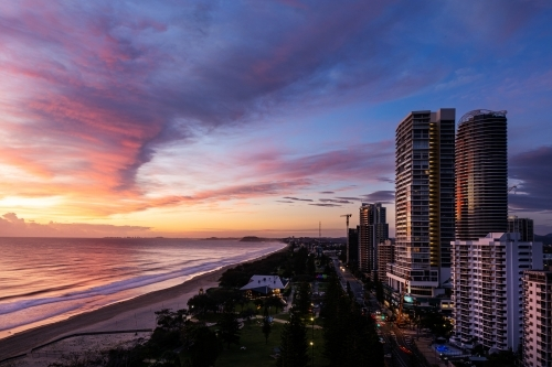 beach and high rise buildings at sunrise