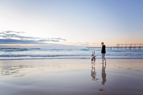 Beach reflections with boy & Dog