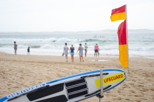Beach scene with life saving flag and equipment