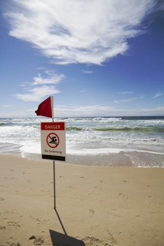 Sign warning of dangerous condition at the beach