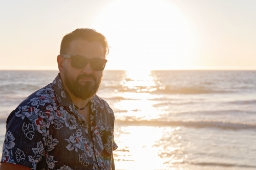 Bearded Man On The Beach At Sunset