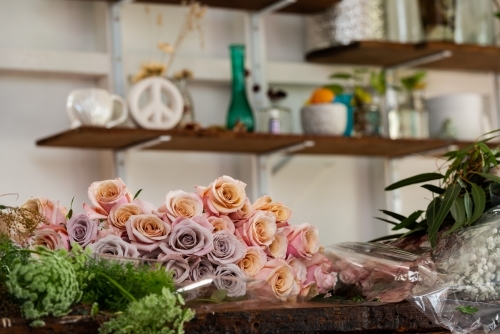 Beautiful roses on a workbench with blurred background