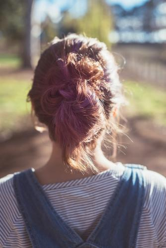 behind view of teenager with purple colour in her hair