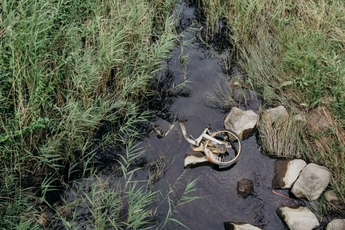 Bicycle dumped in a creek
