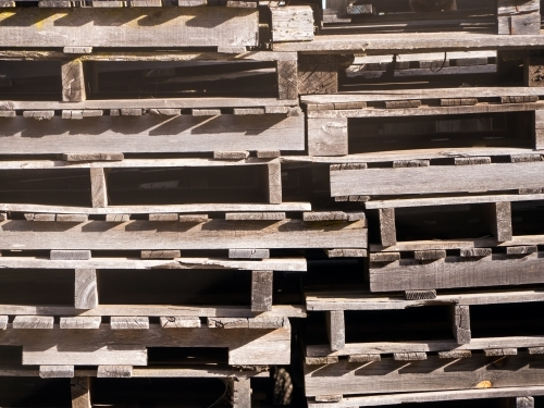 Stack of weathered old wooden pallets