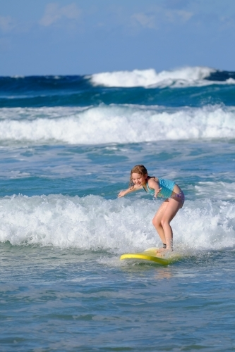 Blonde girl learning to surf on the Gold Coast