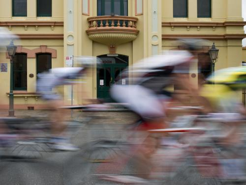 Blurred group of cyclists passing the Armidale Town Hall