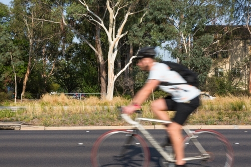 Blurred image of a cyclist commuting to work
