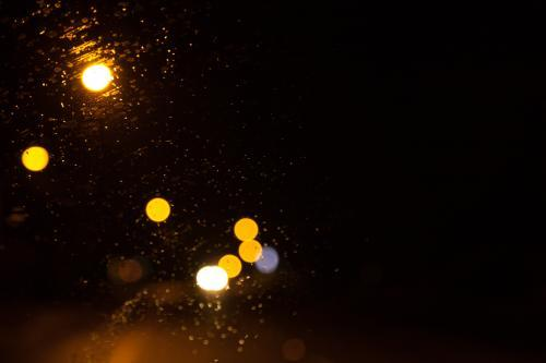 Bokeh street and car lights on the windshield at night