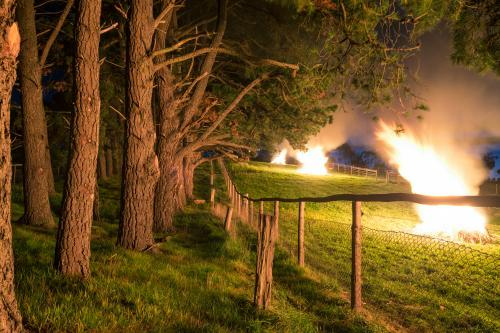 Bonfires in a paddock on a rural property