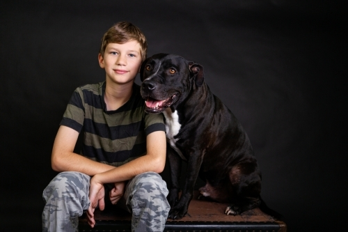 boy and dog in studio portrait