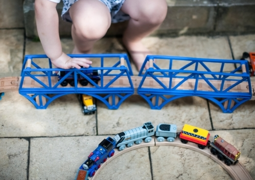 Boy playing with trains