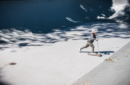 Boy skating in a skate park ramp