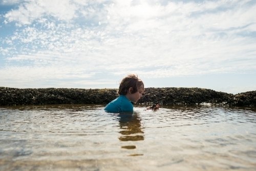 Boy swimming in Rockpool
