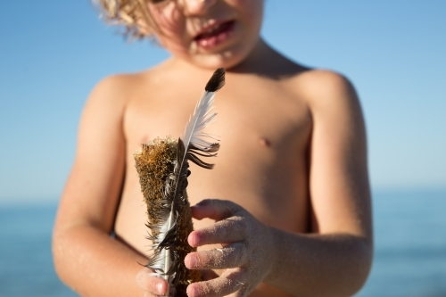 Boy with feather