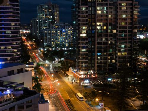 View from above of high rise buildings and traffic in the evening