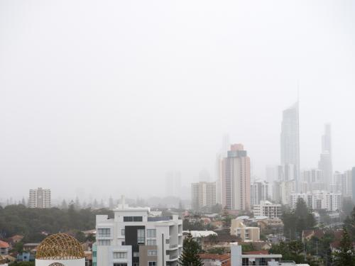 Tall Gold Coast buildings in misty rain