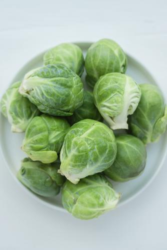 Brussels sprouts in a white dish, overhead